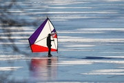 Warm weather brought a ice kiter to Bde Maka Ska as temp soared into the 40s Friday in MInneapolis.
