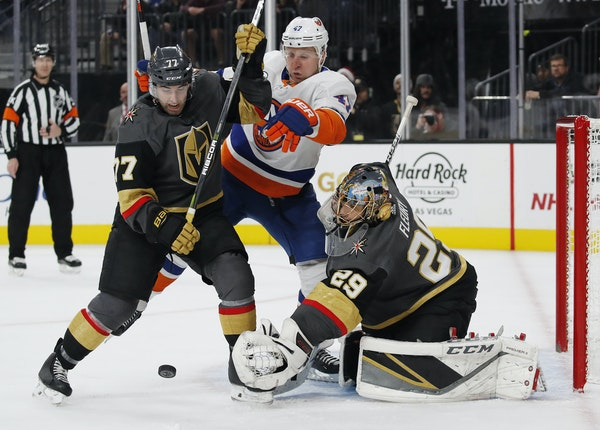 Defenseman Brad Hunt (77), fighting for the puck earlier this season while with the Vegas Golden Knights, brings an offensive approach and experience