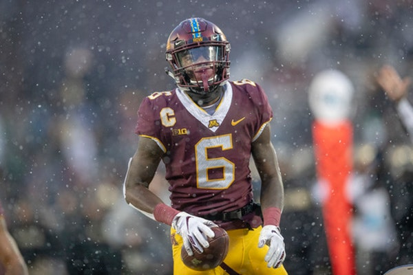 All-Big Ten wideout and former Minneapolis North standout Tyler Johnson tweeted Monday that he won't leave the Gophers early for the NFL draft.