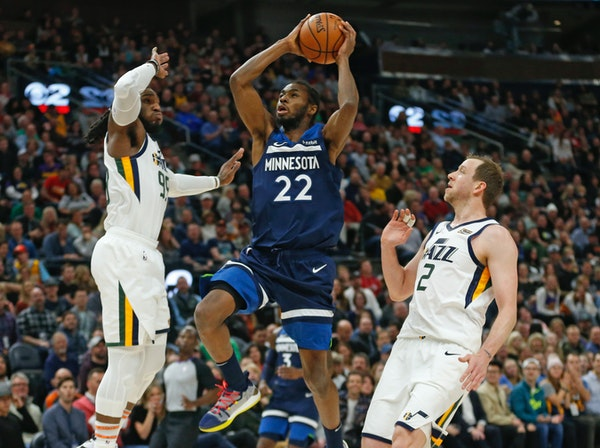 Timberwolves forward Andrew Wiggins goes to the basket as the Jazz's Jae Crowder (99) and Joe Ingles (2) defend during the first half.