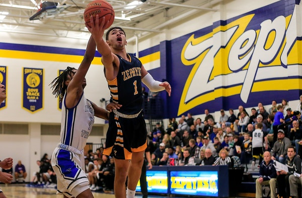 Mahtomedi's J'Vonne Hadley drove to the basket during a 37-point performance against Tartan.