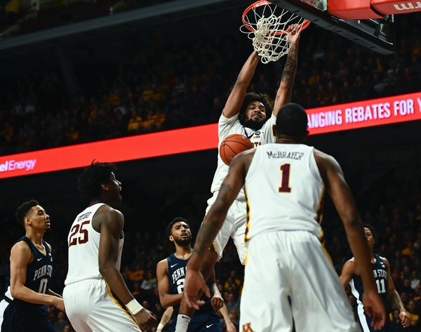 Minnesota Golden Gophers forward Jordan Murphy (3) dunked the ball with an and-one opportunity late in the first half against the Penn State Nittany L