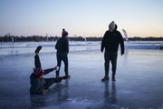 Collin McCullough spilled just a few drops of his coffee when he slipped on the ice while checking out one of the pond hockey rinks with Nick Lazenby,