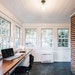 The new office/sunroom has plenty of light, a built-in desk and storage, in-floor heating and energy-efficient windows.