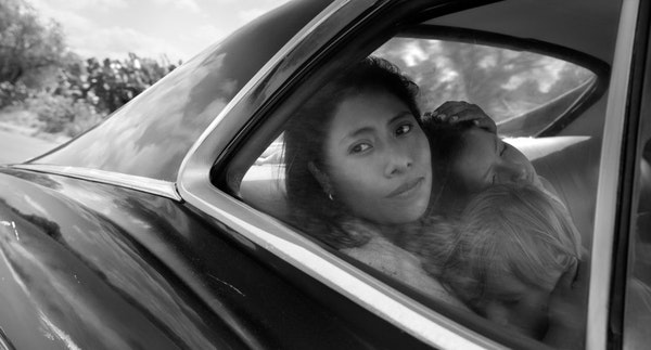 Yalitza Aparicio as Cleo, Marco Graf as Pepe, and Daniela Demesa as Sofi in Roma, written and directed by Alfonso Cuarón. Netflix has scored its firs