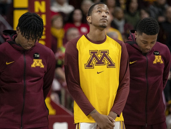 The Gophers' Dupree McBrayer raised his head after a moment of silence honoring his mother, Tayra McFarlane, at Williams Arena.