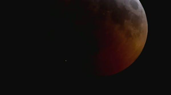 Telescopes capture moon impact during eclipse