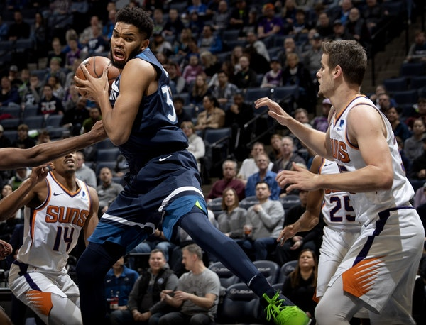 Karl Anthony-Towns grabbed a rebound in the first quarter against Phoenix on Sunday night.