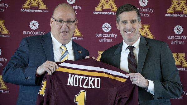 Gophers athletic director Mark Coyle, right, has been pleased with new hires such as men's hockey coach Bob Motzko.