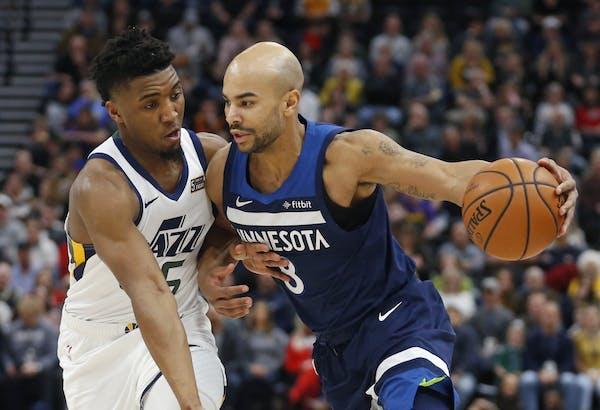 Minnesota Timberwolves guard Jerryd Bayless (8) drives against Utah Jazz guard Donovan Mitchell (45) during the first half of an NBA basketball game F