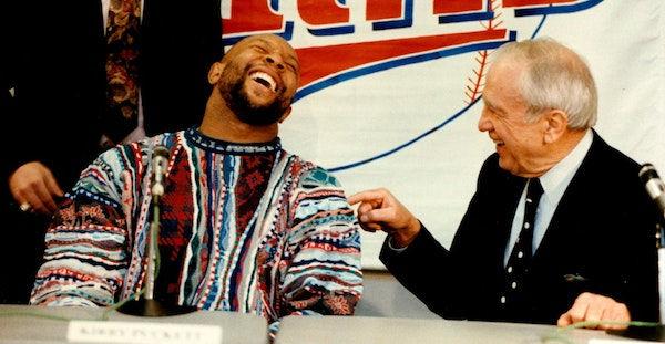 Kirby Puckett enjoyed the moment after signing a five-year, $30 million contract with Carl Pohlad in 1992.