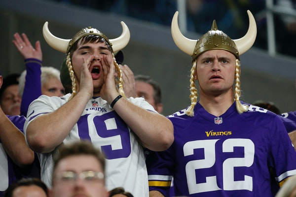 Vikings fans watch from the stands during the second half against the Chicago Bears, a game the Vikings lost ending their season.