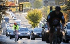 Cyclists and motorists moved along Marshall Avenue, headed eastbound in St. Paul during rush hour in October 2017. LEILA NAVIDI leila.navidi@startribu