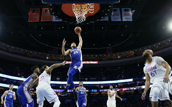 Philadelphia 76ers' Ben Simmons goes up for a dunk during the first half