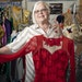 Deborah Nelson, owner of Satin Stitches, with one of her custom dance costumes in her store in Coon Rapids.