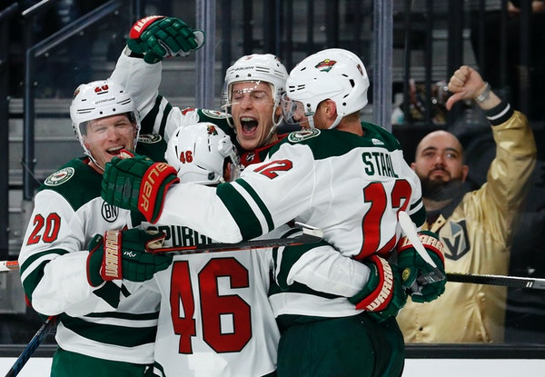 Charlie Coyle, center, was met by teammates after scoring the go-ahead goal in the third period. Jared Spurgeon and Eric Staal, right, assisted.