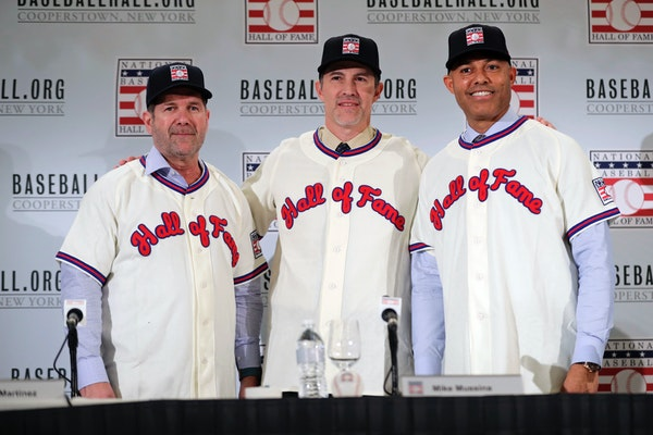 Baseball Hall of Fame inductees Edgar Martinez, left, Mike Mussina, center, and Mariano Rivera, right, pose for photographs during news conference Wed