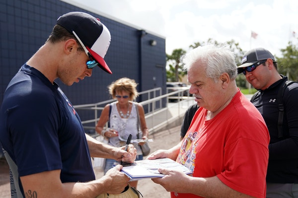 Minnesota Twins right fielder Max Kepler (26) signed autographs for fans after an informal workout at spring training.