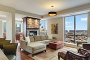 Floor-to-ceiling windows in the corner unit of a $1.875 million condo on the 32nd floor of the Carlyle tower.