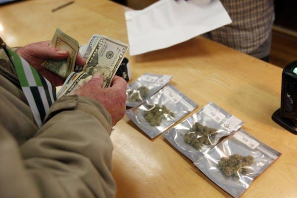 A customer purchases marijuana in Oakland, Calif.