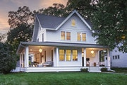 The homey wraparound front porch adds architectural character, outdoor seating areas and shelter from the rain.