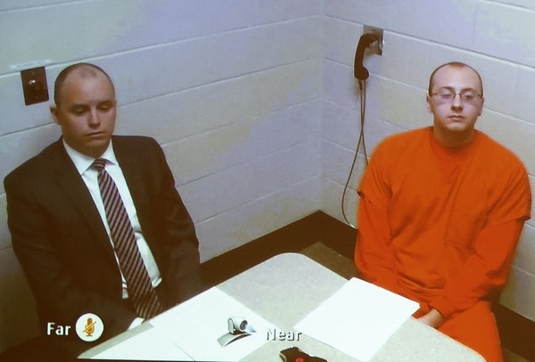 Facing charges: Jake Patterson appeared with one of his attorneys via video. Charging documents sat on the table.