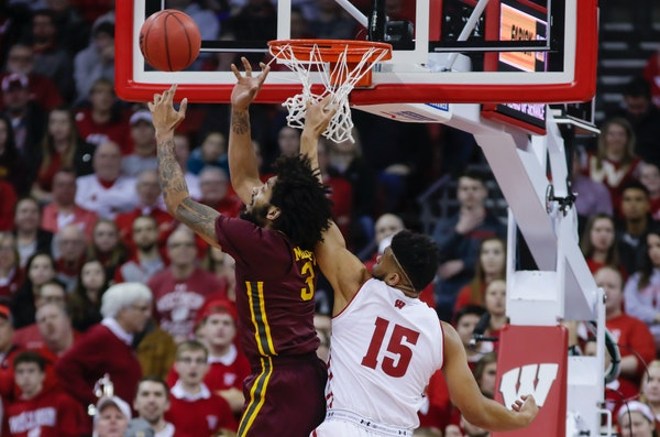 Minnesota's Jordan Murphy went after a defensive rebound against Wisconsin's Charles Thomas on Jan. 3 in Madison.