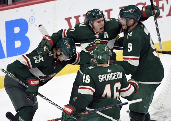 The Wild's Jonas Brodin (25), Jared Spurgeon (46), Zach Parise (11) and Mikko Koivu (9 celebrate a goal by Parise against the Tampa Bay Lightning in O