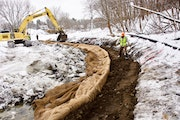 """Workers installed """"soil burritos'' to restore Minnehaha Creek's natural curves in St. Louis Park, part of a project to improve water quality a"""
