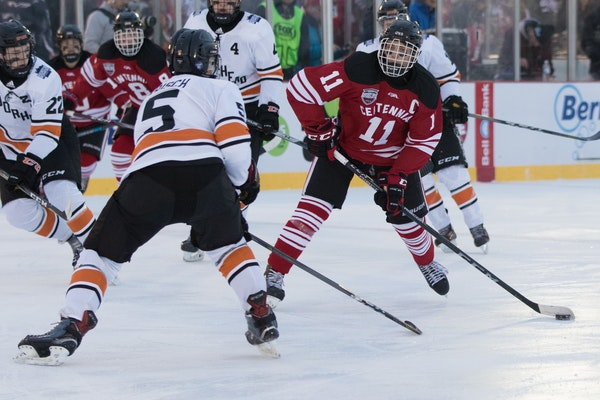 Centennial (in red) battled against Moorhead in a 2018 Hockey Day Minnesota game last January at an outdoor rink built on St. Cloud's Lake George.