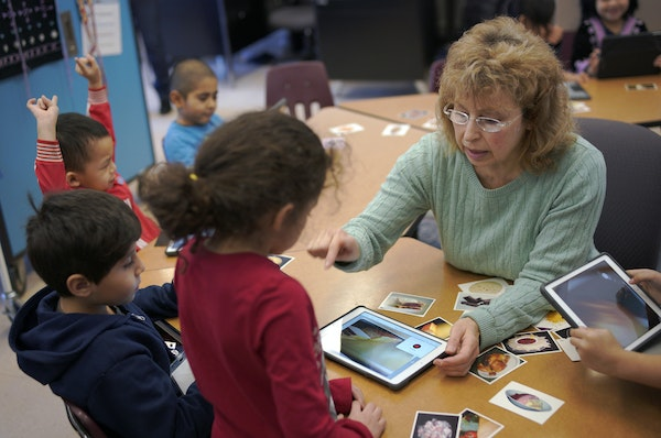 Teacher Anna Grussendorf helps kids with their English language at Mississippi Creative Arts School in St. Paul.