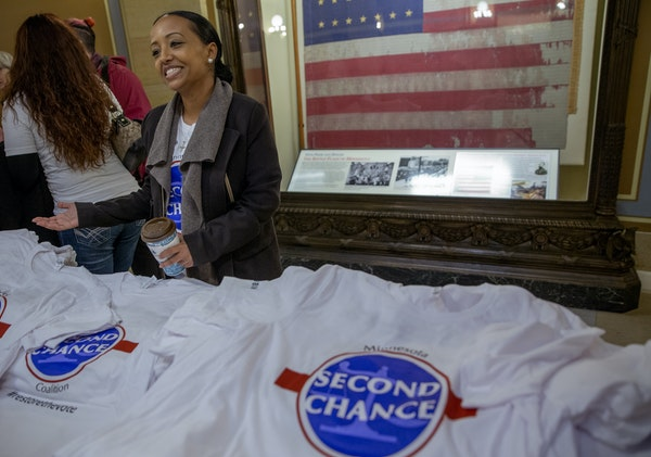 """Beth Benti, a Second Chance Coalition board member, handed out T-shirts during the """"Second Chance Day on the Hill Rally"""" on Thursday. The rally in"""