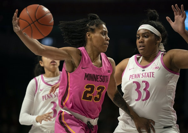Gophers guard Kenisha Bell drove around Penn State forward Lauren Ebo (33) in the first quarter Sunday. Bell shook off an ankle injury to score 17 poi