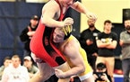 Prior Lake's Calvin Sund works to take down an opponent