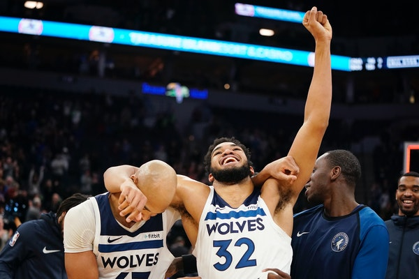 Wolves center Karl-Anthony Towns, who scored the winning basket, and forward Taj Gibson celebrated their 99-97 overtime victory over the Grizzlies on