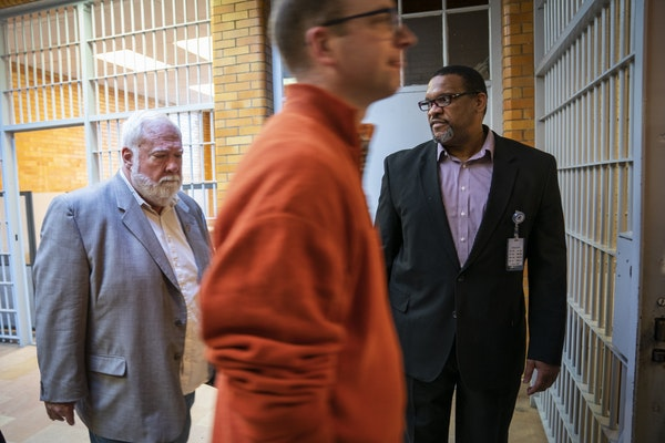 Warden Eddie Miles, right, led Minnesota House members Rep. Jack Considine Jr., left, and Rep. Brad Tabke, center, out of Stillwater prison at the end