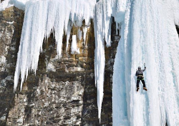 Maintaining a triangular body formation is key for novice ice climbers. MARK JOHANSON • Chicago Tribune