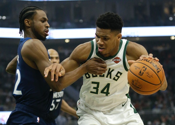 Milwaukee's Giannis Antetokounmpo drives against Timberwolves' Andrew Wiggins during the second half