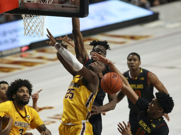 Gophers center Daniel Oturu lost control of the ball underneath, but still had 11 points and 11 rebounds.
