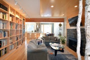 Light woods and birch tree trunks bring a warm organic feel to the interior of the Newlands' home.