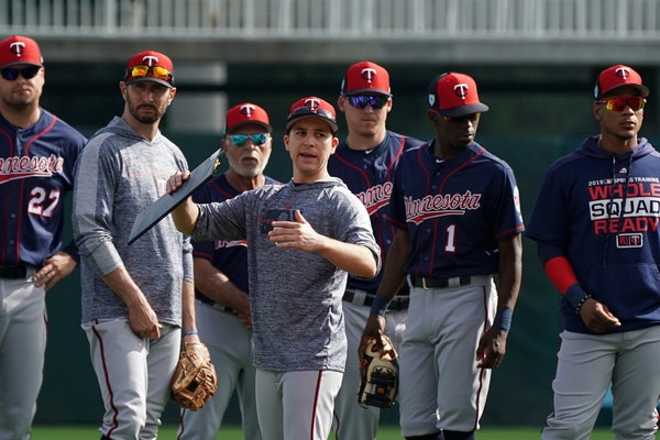 Minnesota Twins Major League advance scout Frankie Padulo gave directions to position players during the first day of full squad workouts Monday.