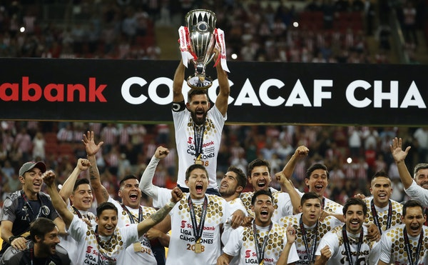 Chivas players held the trophy aloft as they celebrated winning the CONCACAF Champions League final soccer match in Guadalajara, Mexico on April, 25,