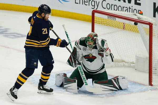 Buffalo forward Kyle Okposo watches the puck go past Wild goalie Devan Dubnyk during the first period