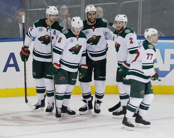 The Wild's Jordan Greenway, center, celebrates his empty-net goal with teammates Eric Staal, left, Ryan Donato, Anthony Bitetto and Brad Hunt