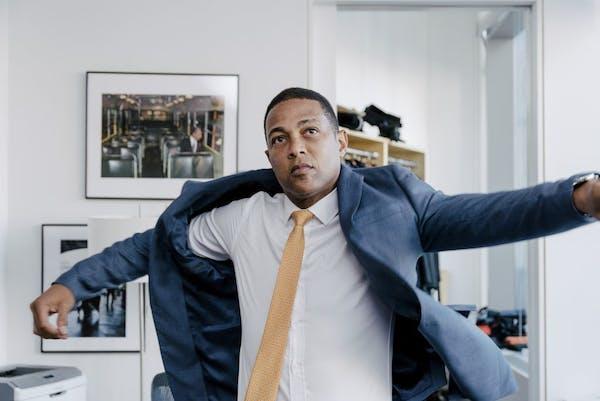 "Don Lemon, host of ""CNN Tonight"" dresses in his office at the Time Warner Building in New York, June 20, 2017. Lemon is under the bright CNN light"