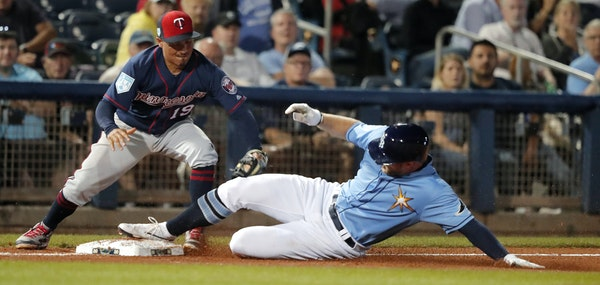 Tampa Bay right fielder Austin Meadows advanced to third base, beating the tag of third baseman Ronald Torreyes during the sixth inning Thursday night