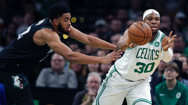 Celtics forward Guerschon Yabusele passes the ball as he is pressured by Timberwolves center Karl-Anthony Towns on Wednesday in Boston.
