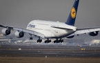 An Airbus A 380 of Lufthansa airline lands the airport in Frankfurt, Germany, Thursday, Feb. 14, 2019. The European plane manufacturer Airbus said Thu