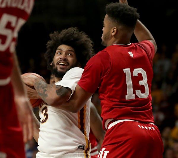 Gophers senior Jordan Murphy fought for a basket against Indiana on Feb. 16.
