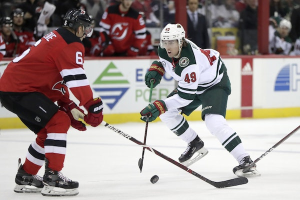 Minnesota Wild center Victor Rask (49), of Sweden, skates against New Jersey Devils defenseman Andy Greene (6) during the first period of an NHL hocke